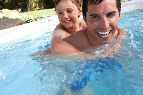 father and son spend quality family time and compare a hot tub to a getaway