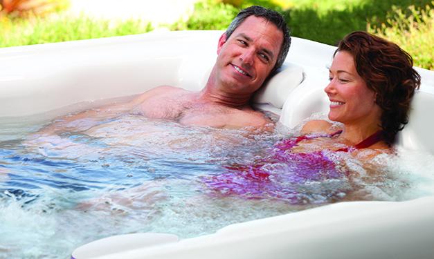 a couple enjoying a soak in a highlife sovereign jacuzzi