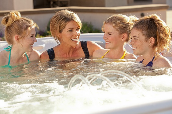 mother and daughters enjoy hot tub activities to build relationships and memories for a lifetime