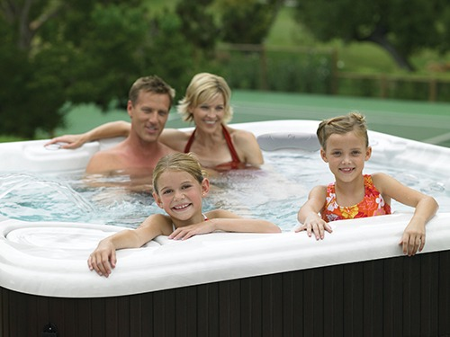 family enjoying the best and easiest hot tub water care system