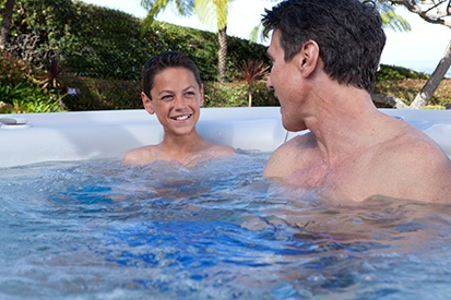 father and son test soak in a hot tub compared to a family vacation pricin