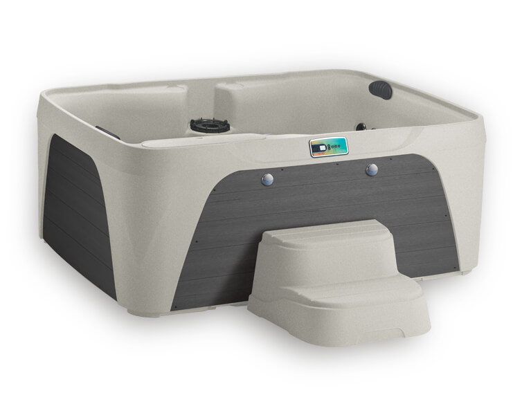 A Fantasy Spas Enamor Hot Tub with a Sand shell and a grey cabinet