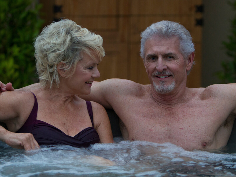 Couple soaking in a Fantasy Hot Tub